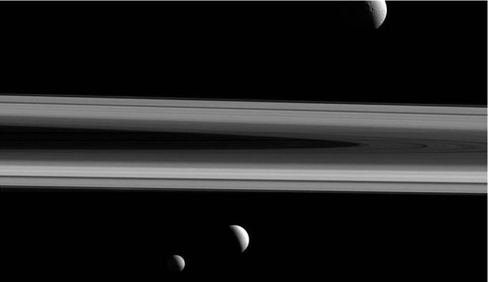 Tethys, Enceladus and Mimas seen above and blow Saturn's rings in a stunning image captured by the NASA / ESA Cassini mission, released on February 22nd, 2016. - are captured in this group photo from NASA's Cassini spacecraft released on Feb. 22. Tethys (660 miles across) appears above the rings, while Enceladus (313 miles across) sits just below center. Mimas (246 miles across) hangs below and to the left of Enceladus. This view looks toward the sunlit side of the rings and was acquired at a distance of approximately 837,000 miles from Enceladus.