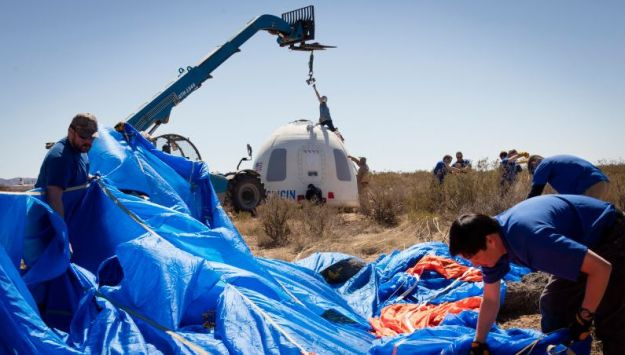 The New Shephard capsule being recovered following its parachute landing (image: Blue Origin)