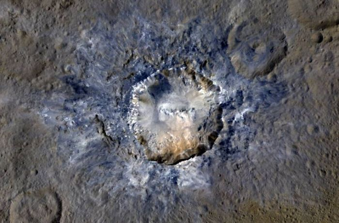 An enhanced colour view Haulani Crater on Ceres (credit: NASA / JPL / UCLA / MPS / DLR / IDA)