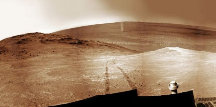 A mosaic of images by Opportunity showing a Martian dust devil (upper centre of the picture), skipping over the terrain behind the rover as it climbs Knudsen Ridge inside Marathon Valley on April 1st, 2016 (credit: NASA/JPL / Cornell / Ken Kremer kenkremer.com / Marco Di Lorenzo)