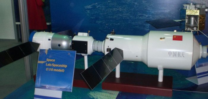 "A model of Tiangong-2, which will be 14.4 metres (47 ft) in length, 4.2 metres (14 ft) in diameter and mass 20 tonnes, seen docked with a crewed Shenzhou (""Divine Craft"") orbital vehicle on the left (Credit: unknown originating source)"