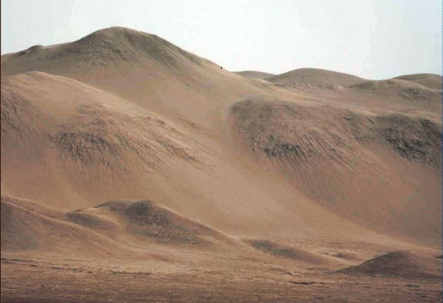 "A white-balanced telephoto view of Gale Crater's rim, as seen from the flank of ""Mount Sharp"""