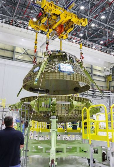 The upper (crewed) dome of the CST-100 STA being mated with the lower instrument bay dome at Boeing's facilities at Kennedy Space Centre in May 2016. Credit: Ken Kramer