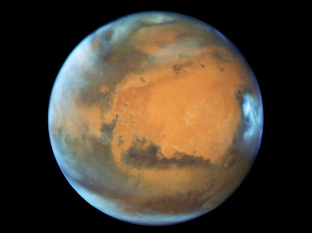 Mars as seen from 80 million km (50 million mi): a Hubble Space Telescope image of Mars captured during opposition on May 12th, 2016. Coincidentally, the Arabia Terra, one of the subjects in the report below, is the dark area in the centre of the image,