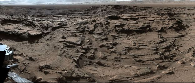 """Naukluft Plateau"", which Curiosity has been traversing since March 2016, shown in close-up, revealing how the surface has been shaped and scoured by the wind over the aeons. In the distance can be seen the rim hills of Gale Crater"