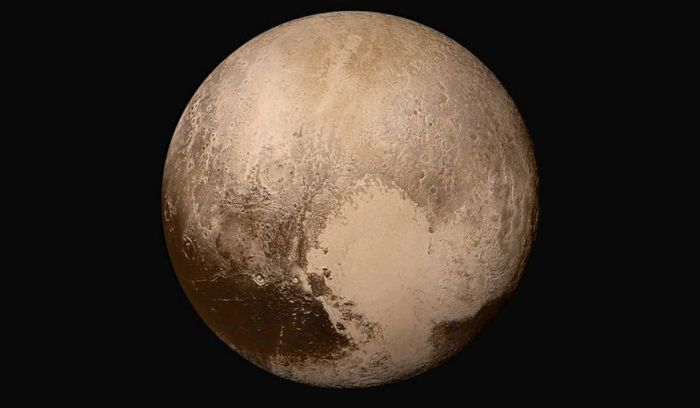 Four images from New Horizons' Long Range Reconnaissance Imager (LORRI) were combined with color data from the Ralph instrument to create this global view of Pluto. The images, taken when the spacecraft was 280,000 miles (450,000 kilometers) away from Pluto, show features as small as 1.4 miles (2.2 kilometers). Credits: NASA/JHUAPL/SwRI