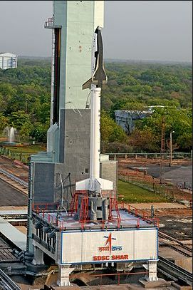 India's 6.5 metre long reusable launch vehicle technology demontrator (RLV-TD) sits atop its launch booster, prior to the 770-second test flight on May 22nd