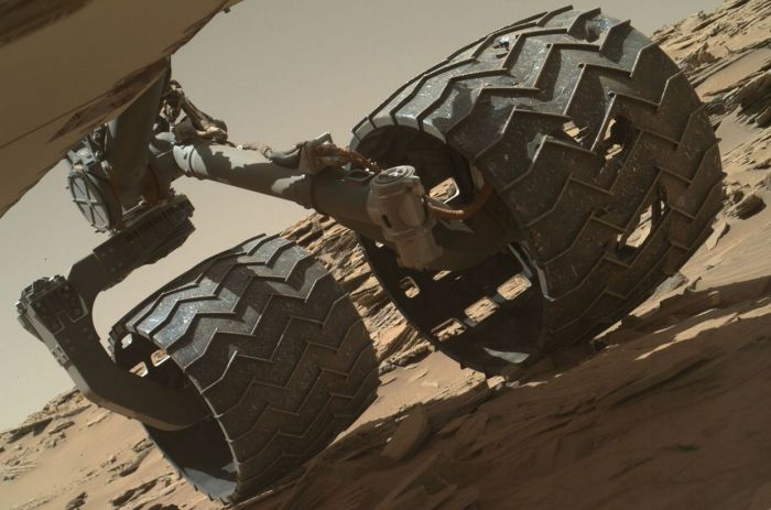 This image taken on April 18th, 2016 (Sol 1,315) by the Mars Hand Lens Imager (MAHLI) camera on the rover's robot arm revels areas of damage on Curiosity's centre left wheel, the result of periodically traversing very rough terrain since the rover arrived on Mars in 2012