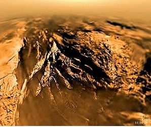 An image of Titan's surface, as taken by the European Space Agency's Huygens probe as it plunged through the moon's thick, orange-brown atmosphere on Jan. 14, 2005. Credit: ESA / NASA / JPL / Univ. of Arizona