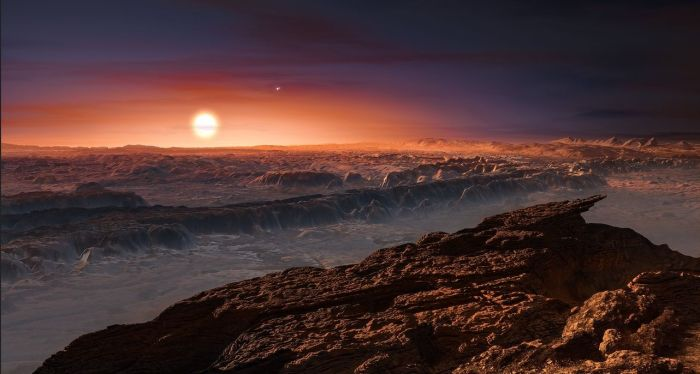 An artist's impression of Proxima b with Proxima Centauri low on the horizon. The double star above and to the right of it is Alpha Centauri A and B. Credit: ESO