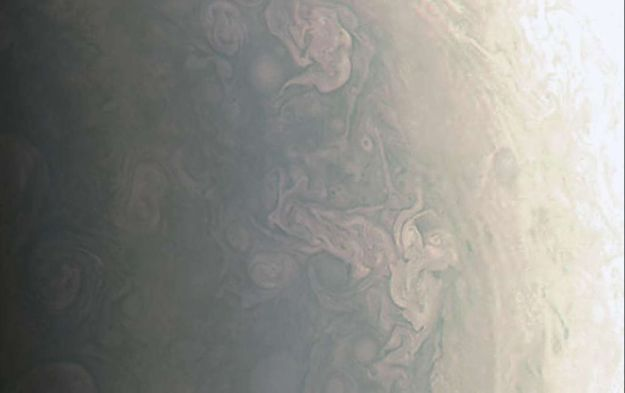 An enhanced view of the north polar hurricane-like clouds images by Juno on August 27th, 2016