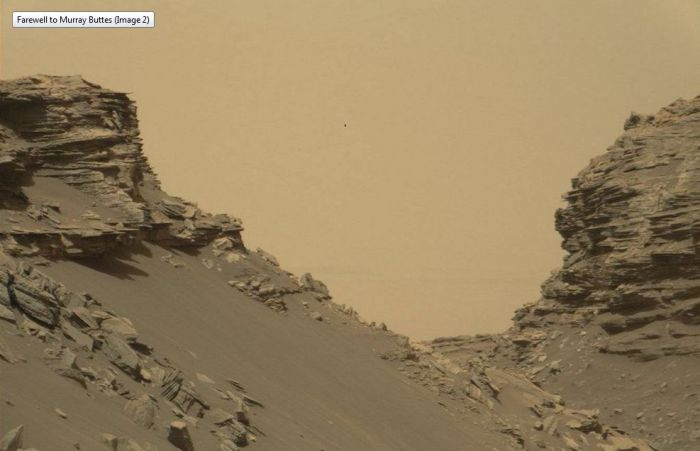 Murray Buttes with the faint outlines of Gale Crater beyond, as images on Thursday, September 8th 2016, by NASA's Curiosity rover during its 1m454 sol on Mars. Credit: NASA/JPL / MSSS