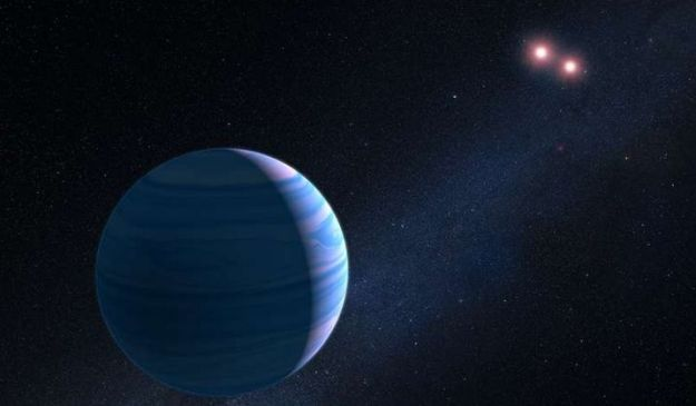 An artist's impression of the Saturn-like planet orbiting the red dwarf binary pair of OGLE-2007-BLG-349. The two tiny stars are just 11.2 million km apart, and the planet orbits them at a distance og 480 million km. It is the first time the Hubble Space Telescope has used gravitational microlensing to confirm an exoplanet. Credit: G. Bacon (STScI).