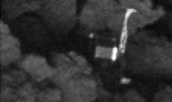"""A further enhancement reveals Philae to be effectively """"tipped over"""" within the cleft, further limiting its solar panels to sunlight, as the missions team had theorised. Credit: ESA/Rosetta/MPS for OSIRIS Team MPS/UPD/LAM/IAA/SSO/INTA/UPM/DASP/IDA"""