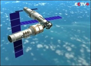 an artist's impression of Tiangong-2 (centre right) with the Tianzhou resupply vehicle docked (left), together with the Shenzou-12 crew vehicle at the laboratory's far docking port