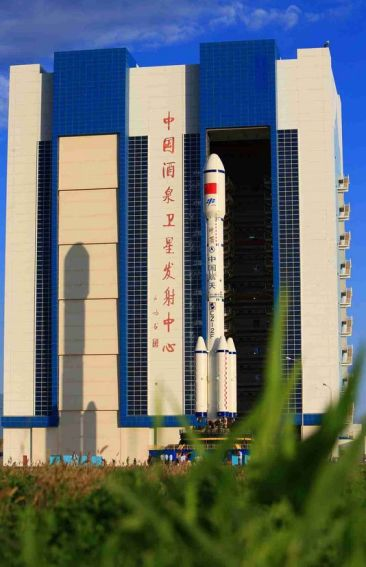 Tiangong-2, mounted on the top of its Long March 2F launch vehicle, emerged from its vehicle assembly building at China's Jiuquan Space Centre on September 9th, en route to the launch pad for an anticipated September 15th lift-off