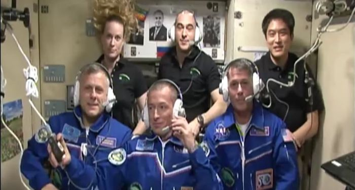 Andrey Borisenko (l), Sergei Ryzhikov (c), and Shane Kimbrough during a public broadcast just after they'd boarded the space station, with colleagues Kate Rubins, Anatoly Ivanishin and Takuya Onishi, behind them