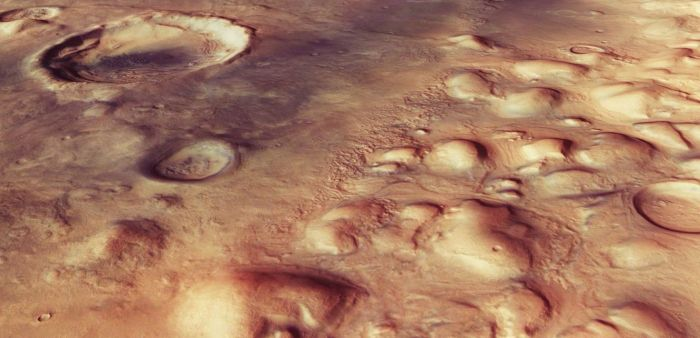 A high resolution image of Colles Nili from a slightly different perspective reveals the rounded hills, together with the faint ridges and troughs, many of which cut through impact craters, suggesting the passage of glaciers over several million years