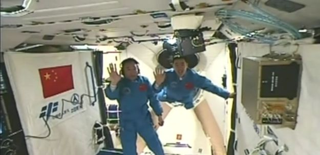 Jing Haipeng (l) and Chen dong (r) aboard Tiangong-2. Credit: CCTV