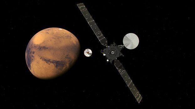 An artist's impression of ESA's Trace Gas Orbiter approaching Mars on October 16, 2016, having just released the Schiaparelli lander demonstrator