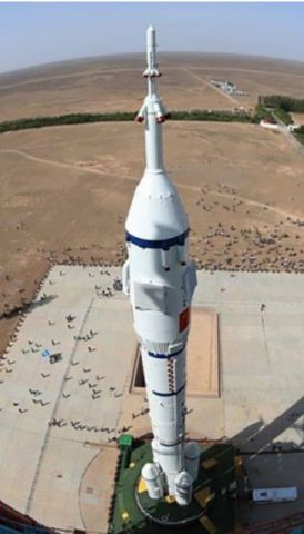 An unusual view of Shenzhou-11 from the top of the launch gantry. Credit: CCTV