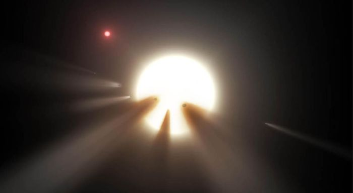 Artist's impression of an orbiting swarm of dusty comet fragments around Tabby's Star. Could these be responsible for its peculiar dips in brightness or is there a biological reason? A small red dwarf star (above, left) lies near Tabby's. Credit: NASA / JPL
