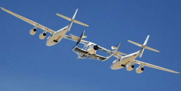 VSS Unity suspended between launch / carry aircraft WhiteKnightTwo during its only captive / carry flight in September 2016. Credit: Virgin Galactic