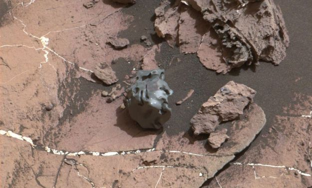 The dark, smooth-surfaced rock at the center of this Oct. 30, 2016, image from the Mast Camera (Mastcam) on NASA's Curiosity Mars rover was examined with laser pulses and confirmed to be an iron-nickel meteorite. It is about the size of a golf ball. Credit: NASA/JPL-Caltech/MSSS