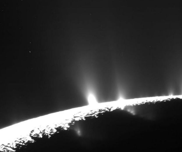 Geyser on Enceladus, orbiting within the E-ring through vast amount of ice particles into space, replenishing and supporting the E-ring. Credit: NASA/JPL / Space Science Institute