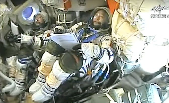 Jing Haipeng (foreground) and Chen Dong aboard the Shenzhou 11 vehicle prior to re-entry into Earth's atmosphere, Friday, November 18th