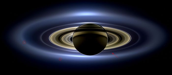 "On July 19th, 2013, Cassini captured this remarkable shot of Saturn and its entire ring system as they eclipsed the Sun. captured at a distance of 1.2 million km (746,000 mi) from the planet. It spans a distance of 651,591 km (404,880 mi) across and uses 141 wide-angle shots collected over a 4-hour period, and shows the haze of Saturns's outer most ""E"" ring and, inward of it, the ""G"" ring, with Earth a tiny dot (arrowed) sitting between them. The more discrete ring system from the ""F"" ring through to the innermost ""D"" ring are visible, together with seven of Saturn's moons, of which two are ringed: Enceladus, on the left (see below) and Tethys, lower left). The colours seen are true, and have not been artificially enhanced Credit: NASA/JPL / Space Science Institute"