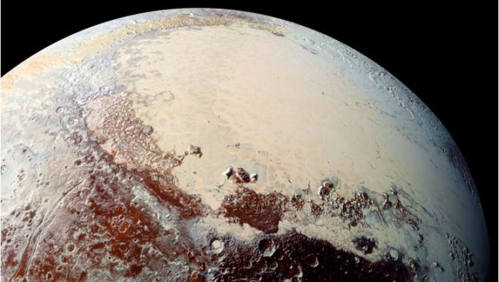 """""""Sputnik Planum"""" (the left lobe of Pluto's """"heart"""") is believed to be a """"positive mass anomaly"""" which has contributed to the planet's axial tilt, and to the planet's developing weather systems and look, to the point where today, the weather is as much accountable for the planet's looks and position in space and any other factor influencing it. Credit: James Keane"""