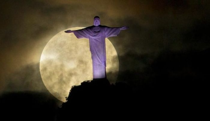 A dramatic supermoon is seen behind the Christ the Redeemer statue in Rio de Janeiro, in May 2012. Credit: AP Photo/Victor R. Caivano