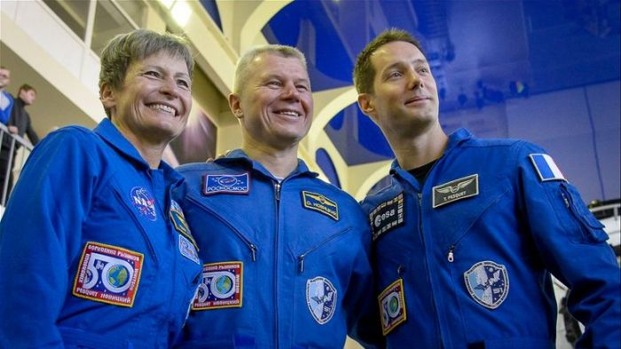 Peggy Witson with Oleg Novitsky and Thomas Pesquet posing for photographs prior to launch. Via: Peggy Whitson