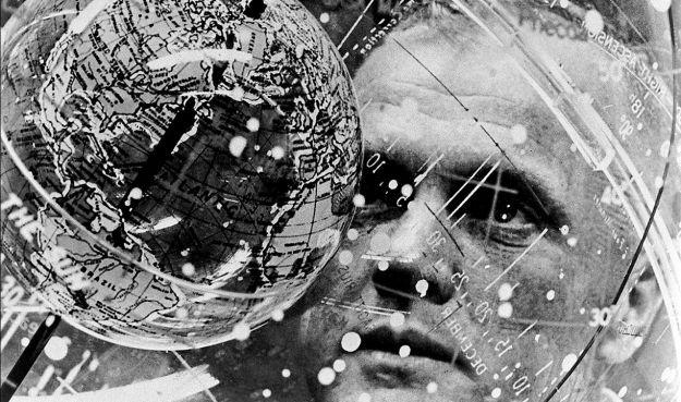 An unusual shot of John Glenn as he examines a celestial training device in preparation for his Mercury-Atlas orbital launch in February 1962. Credit: NASA