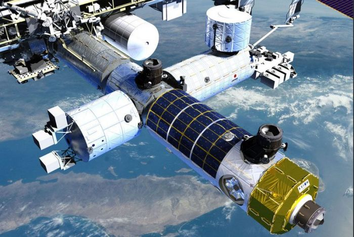 Axiom would commence its space station by adding a module to the ISS (seen with the solar power panels wrapped around the module's hull). Credit: Axiom International
