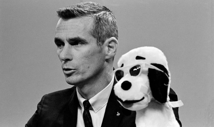 Gene Cernan in 1969, ahead of the Apollo 10 flight during a NASA press conference. A Snoopy toy sits next to him, indicative of the Apollo 10 lunar module call sign