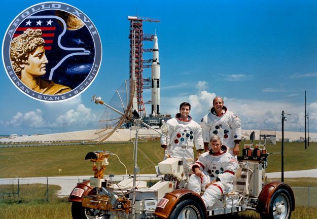 The Apollo 17 crew: seated in the lunar rover replica is Gene Cernan, with Harrison Schmitt to the left behind him, and Ronald Evans to the right