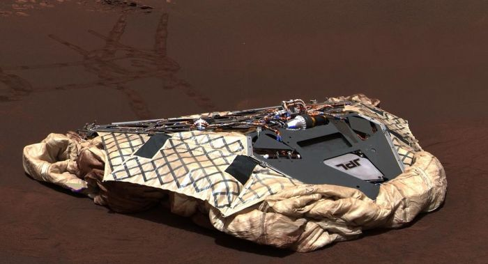 Opportunity's lander, with the airbags used to protect vehicle and lander as they bounced across Mars on their arrival, deflated and retracted beneath it. The lander was renamed Challenger Memorial Station on the occasion of the 18th anniversary of the Challenger disaster. Credit: NASA