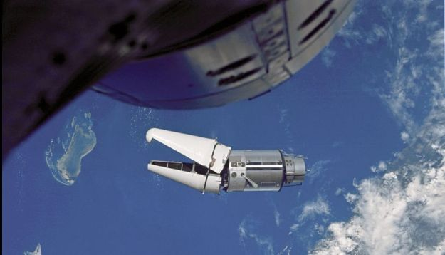 """The """"angry alligator"""" of the Agena target vehicle with launch shroud elements still attached, as seen from Gemini 9A on June 3rd, 1996. The nose of the Gemini vehicle can be seen at the top of the image, and the craft were some 20.3 metres (66ft) apart"""