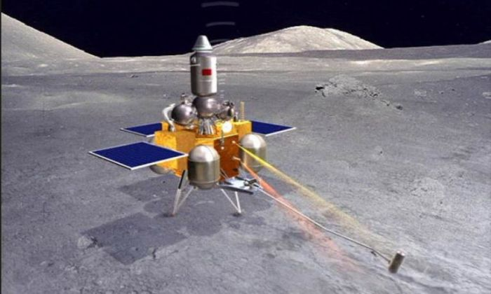 The Chang'e 5 lander module with deployed sample gathering mechanism. The silver ascent unit sits atop it. Credit: Xinhua news agency