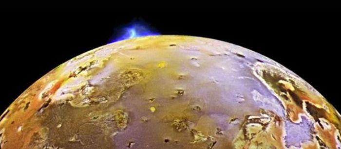 A false colour enhanced image of a volcanic plume above Io. Credit: NASA