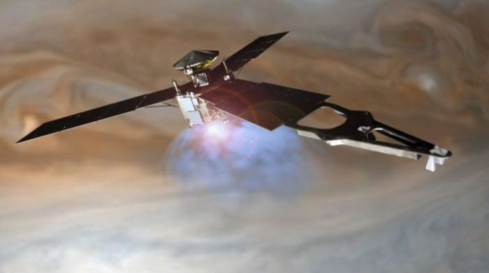 An artist's impression of Juno firing its main engine at it passes over Jupiter's cloud tops. Credit: NASA