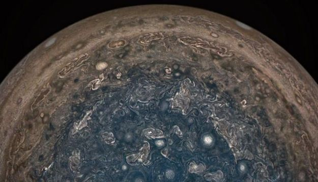 This stunning enhanced colour images of Jupiter's south polar region was captured by the JunoCam instrument aboard the Juno spacecraft on February 2nd, 2017. It reveals a complex series of interactions occurring in the fast-spinning atmosphere