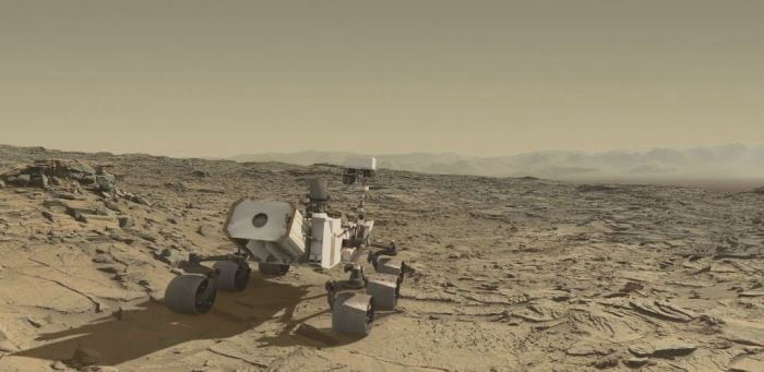 "A simulated Curiosity rolls over the ""Naukluft Plateau"" in this still from Seán Doran's video simulation of the rover's traverse"