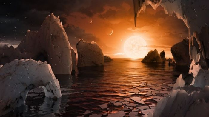 Another artist's impression of how the TRAPPIST system might look from the surface of one of the worlds - assuming they have liquid water present
