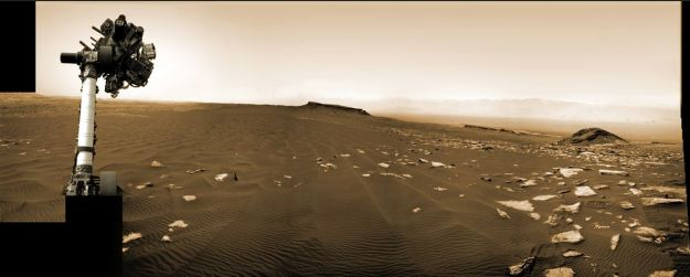 """Sol 1,65, March 2017: with its robot arm raised, Curiosity examines another area of the """"Bagnold Dunes"""" on """"Mount Sharp"""", a area it first examines lower down the side of the mound in December 2015 / January 2016. Credit: NASA / JPL / M. Di Lorenzo"""