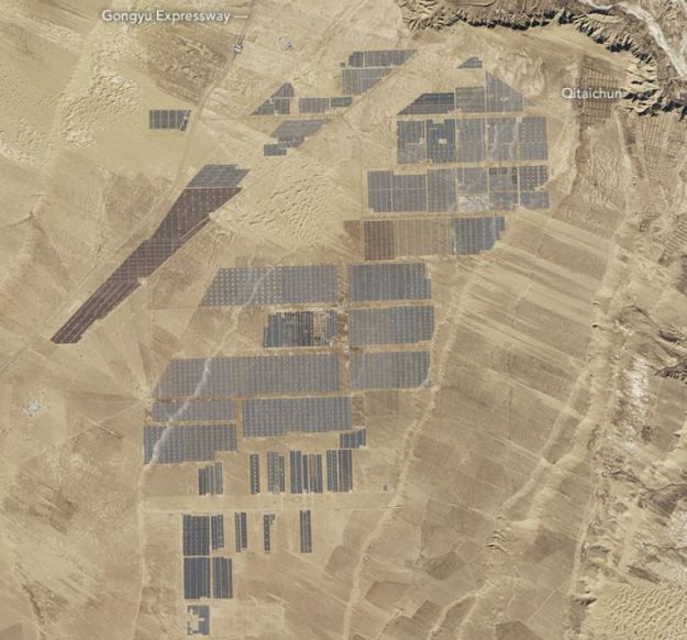 The Longyangxia solar farm, China. In 2016, China installed the equivalent of one and a half soccer fields of solar panels every hour. Credit: NASA / Landsat
