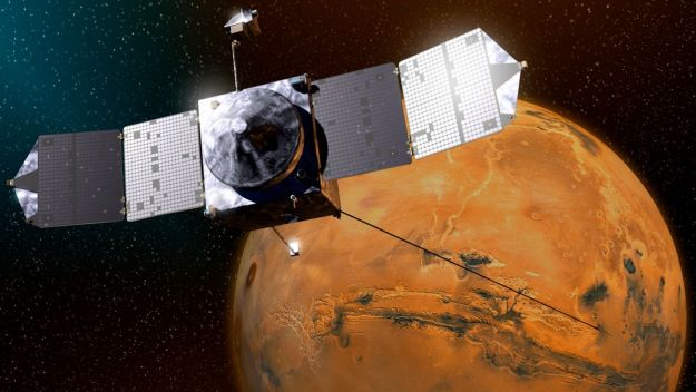 An artist's impression of MAVEN as it looks down on Mars' Vallis Marineris. The NASA mission, which arrived in orbit in September 2014, is studying the Martian atmosphere
